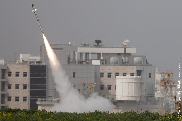 An Israeli missile is launched from the Iron Dome missile system in response to a rocket launch from the nearby Palestinian Gaza Strip, on March 12, 2012 near Ashdod
