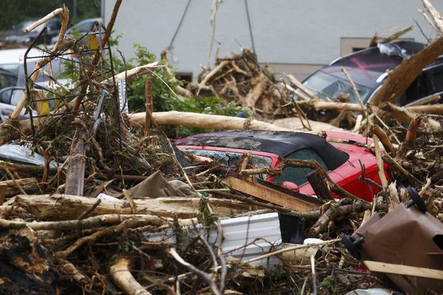 Cars and debris are pictured after floods in the town of Braunsbach, Germany, May 30, 2016. (Photo by Kai Pfaffenbach/Reuters)