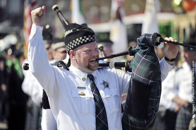 A member of the Bagpipes and Drums of the Chicago Police Emerald Society calls out a tune at the St. Patrick's Day parade