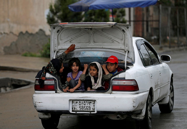 Children ride in the trunk of a car in Kabul, Afghanistan May 15, 2017. (Photo by Mohammad Ismail/Reuters)