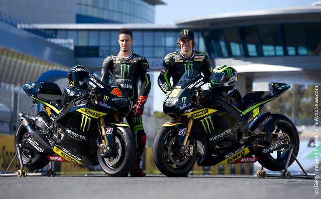 (L-R) Andrea Dovizioso of Italy and  Yamaha Tech 3 and Cal Crutchlow of Great Britain and Monster Yamaha Tech 3 pose with the bikes on track during the MotoGP Tests In Jerez at Circuito de Jerez