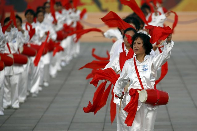 Performers dance with drums ahead of IOC's announcement of the winner city for the 2022 winter Olympics bid, outside the Birds' Nest, also known as the National Stadium, in Beijing, China, July 31, 2015. Beijing officials on Friday highlighted the nation's ability to deliver on promises as the Chinese capital, the frontrunner in the race, made its final pitch to the International Olympic Committee on Friday. (Photo by Damir Sagolj/Reuters)
