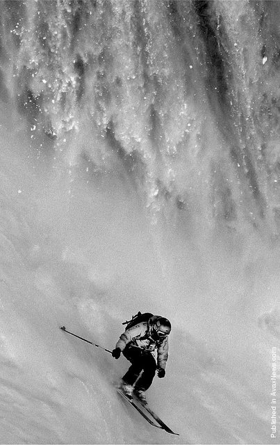 Professional freeride skier Phil Meier (Switzerland) escapes an oncoming avalanche during Freeride Quest, a qualifying event for Xtreme Verbier, the freeriding world championship