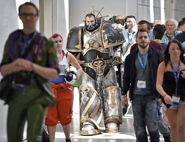 A  costumed participant arrives at the gamescom  computer game  fair in Cologne, Germany, Wednesday, August 5, 2015. (Photo by Martin Meissner/AP Photo)