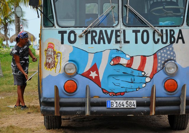 A bus with the Cuban and US flags is seen on a beach in Havana, on August 12, 2015. Cuba and the United States have restored full diplomatic relations last month after more than a half century of enmity. (Photo by Yamil Lage/AFP Photo)