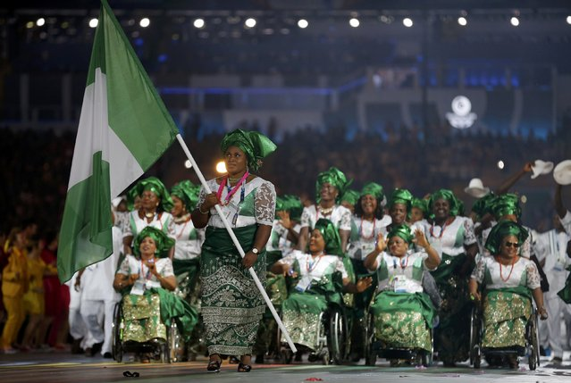 The flag of Nigeria is carried by Maryam Usman as the team enters the stadium during the opening ceremony for the 2014 Commonwealth Games at Celtic Park in Glasgow, Scotland, July 23, 2014. (Photo by Jim Young/Reuters)