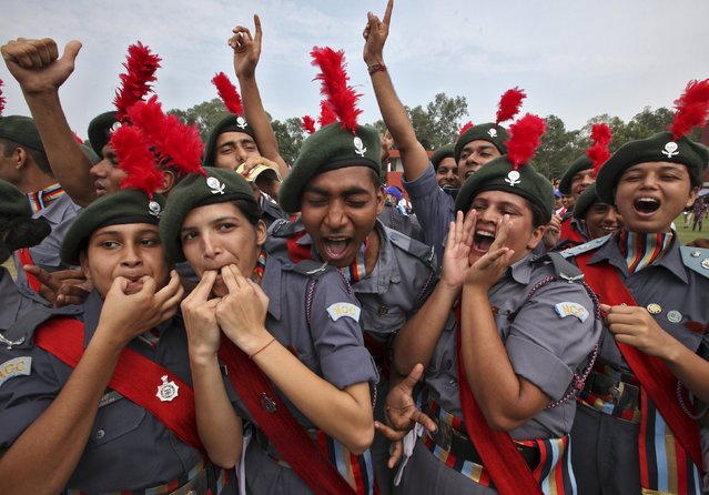 "Cadets from the National Cadet Corps (NCC) celebrate after being awarded the first position in the best marching trophy competition during India's Independence Day celebrations in Chandigarh, India, August 15, 2015. Indian Prime Minister Narendra Modi's independence day speech focused on measures his ""Team India"" had rolled out to include millions of poor Indians in the banking and insurance systems, policies for workers and farmers and successes in the fights against inflation and corruption. (Photo by Ajay Verma/Reuters)"