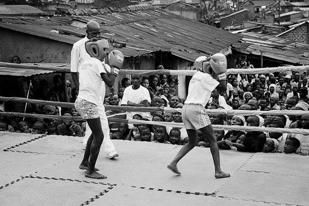 August 31, 2013 – Kampala, Uganda. Kids box at the Rhino Boxing Club during a boxing event. (Photo by Peter Bauza/ZUMA Press/VISUAL Press)