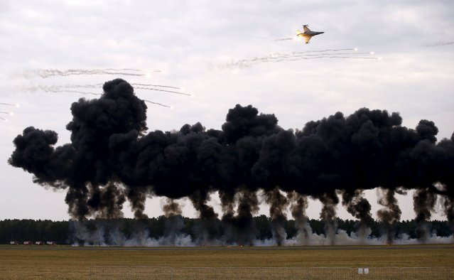 Poland's military airplanes perform an attack simulation during the Radom Air Show at an airport in Radom, Poland August 23, 2015. (Photo by Kacper Pempel/Reuters)