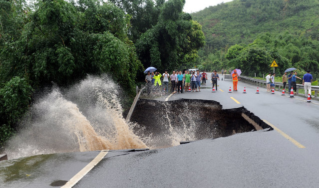 A road is seen damaged by heavy rainfall as Typhoon Nepartak lands in Fuzhou, Fujian Province, China, July 9, 2016. (Photo by Reuters/Stringer)