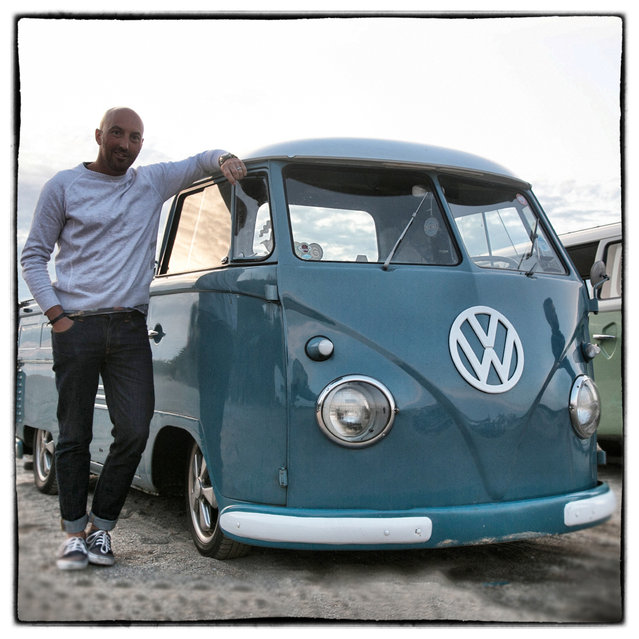 Matt Lawton, 41, from Stoke on Trent poses for a photograph besides his 1959 first generation or T1, split-screen Volkswagen Transporter pick-up van in Newquay on August 7, 2014 in Cornwall, England. (Photo by Matt Cardy/Getty Images)