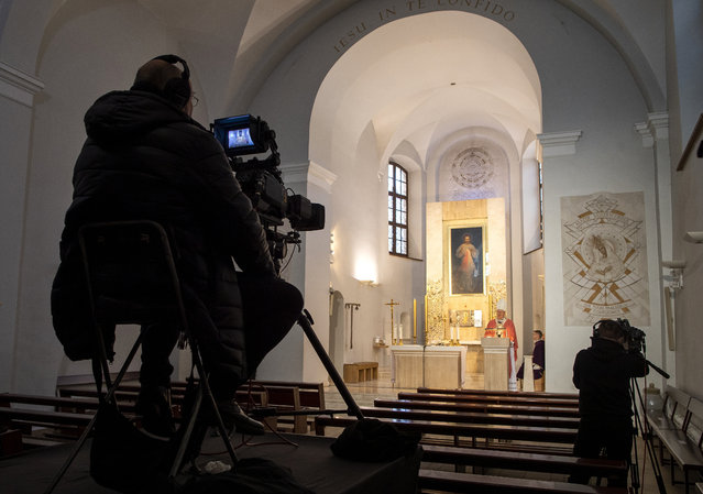 Lithuania's Archbishop Gintaras Grusas speaks during a live broadcast of the Holy Mass at an empty catholic church The Shrine of Divine Mercy in Vilnius, Lithuania, Sunday, March 22, 2020. The catholic church in Vilnius start to stream several services on the internet from Sunday, March 22. The church cancelled all worship services but is open only for single prayers. All public and private events are banned in Lithuania, clubs, bars restaurants and most shops are closed due to the virus outbreak. For most people, the new coronavirus causes only mild or moderate symptoms, such as fever and cough. For some, especially older adults and people with existing health problems, it can cause more severe illness, including pneumonia. (Photo by Mindaugas Kulbis/AP Photo)