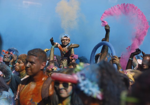 Participants celebrate amid colored powder while taking part in the Color Run race in Tegucigalpa, Honduras August 30, 2015. (Photo by Jorge Cabrera/Reuters)