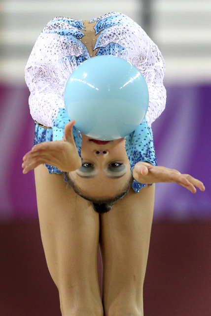 Jana Berezko-Marggrander of Germany performs with the ball during the Individual All-Around Rhythmic Gymnastics Finals at the Youth Olympic Games Wednesday, August 25, 2010, in Singapore. (Photo by Wong Maye-E/AP Photo)