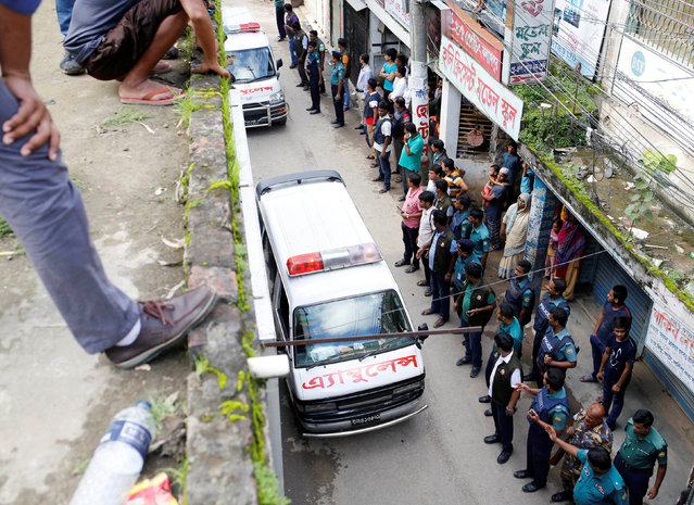 Ambulances leave after a police operation on militants on the outskirts of Dhaka, Bangladesh, July 26, 2016. (Photo by Mohammad Ponir Hossain/Reuters)