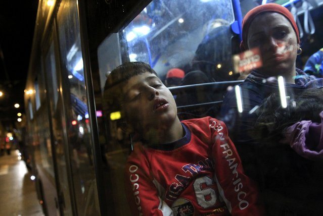 A boy sits in a bus, which is supposed to leave to Austria and Germany, at the Keleti trainstation in Budapest, Hungary, September 4, 2015. (Photo by Bernadett Szabo/Reuters)