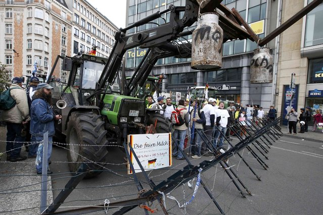 Farmers and dairy farmers from all over Europe take part in a demonstration outside an European Union farm ministers emergency meeting at the EU Council headquarters in Brussels, Belgium, September 7, 2015. (Photo by Jacky Naegelen/Reuters)