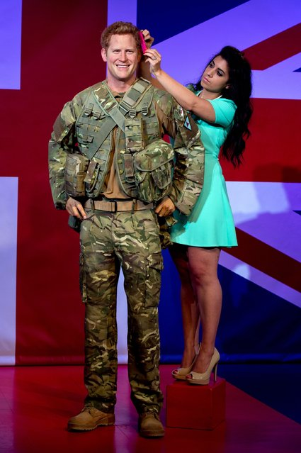 A new wax figure of Prince Harry is unveiled at Madame Tussauds on September 9, 2014 in London, England. (Photo by Ben A. Pruchnie/Getty Images)