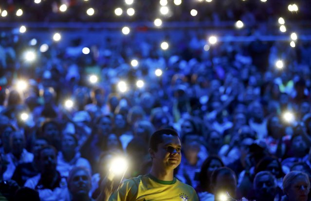 2016 Rio Olympics, Opening ceremony, Maracana, Rio de Janeiro, Brazil on August 5, 2016. Spectators use their mobile phones for illumination. (Photo by Kai Pfaffenbach/Reuters)