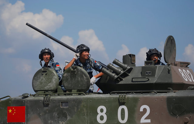 Chinese servicemen sit atop an armoured infantry fighting vehicle during the Paratrooper's platoon competition for airborne squads, part of the International Army Games 2016, at the Rayevsky shooting range outside the Black Sea port of Novorossiysk, Russia, August 8, 2016. (Photo by Maxim Shemeto/Reuters)
