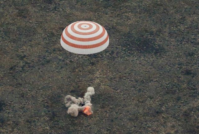 The Soyuz TMA-16M capsule carrying the crew of Gennady Padalka of Russia, Aidyn Aimbetov of Kazakhstan and Andreas Mogensen of Denmark, is seen as it lands near the town of Dzhezkazgan (Zhezkazgan), Kazakhstan, September 12, 2015. (Photo by Yuri Kochetkov/Reuters)