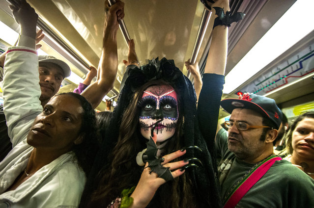 A woman dressed up for Halloween travels on a Metro train in São Paulo, Brazil on October 30, 2017. (Photo by Cris Faga/Rex Features/Shutterstock)