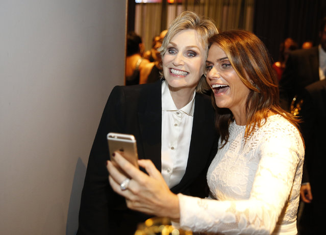 Jane Lynch, left, and Amy Landecker pose backstage at the Television Academy's Creative Arts Emmy Awards at Microsoft Theater on Saturday, September 12, 2015, in Los Angeles. (Photo by Colin Young-Wolff/Invision for the Television Academy/AP Images)