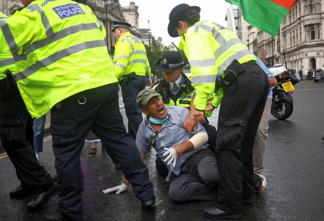 Police officers detain a protester near the Houses of Parliament, after the departure of Britain's Prime Minister Boris Johnson, in London, Britain, June 17, 2020. (Photo by Hannah McKay/Reuters)