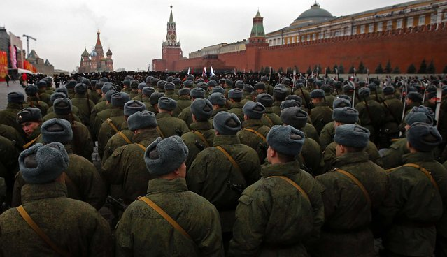 Russian soldiers dressed in Red Army World War II uniforms prepare to march during a rehearsal for a November 7 parade in Moscow's Red Square, November 2, 2012. The parade marks the 71st anniversary of a  parade on Red Square when soldiers went directly to the front during World War II. For decades November 7 was a holiday celebrating the 1917 Bolshevik Revolution. (Photo by Misha Japaridze/Associated Press)