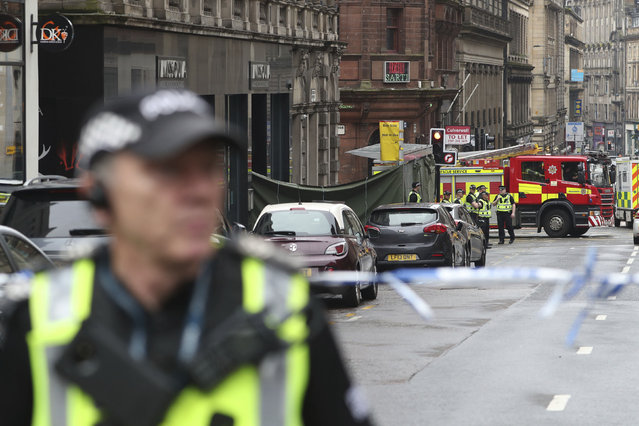 Emergency services attend the scene of an incident in Glasgow, Scotland, Friday June 26, 2020. Police in Glasgow say emergency services are currently dealing with an incident in the center of Scotland's largest city and are urging people to avoid the area. (Photo by Andrew Milligan/PA Wire via AP Photo)