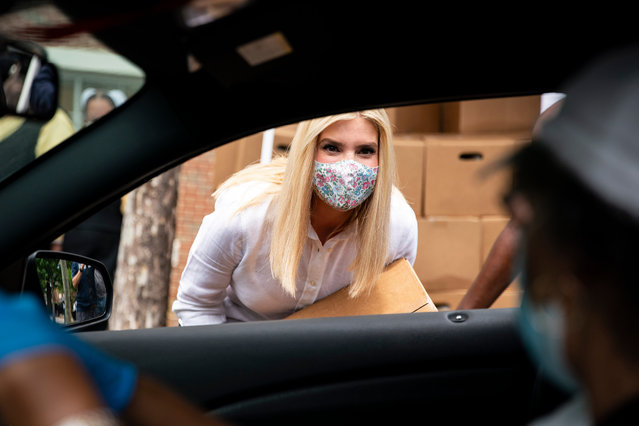 Ivanka Trump speaks to a driver as she distributes food boxes To those in need as part of the Farmers to Families food box program in Washington DC, US on Tuesday, June 16, 2020. Trump traveled to Pittsburgh today to meet with local African American leaders at an event meant to highlight opportunity zones and a food box program and was her first public appearance since she accompanied President Donald Trump for a photo at a historic church near the White House earlier this month. (Photo by Al Drago/Getty Images)
