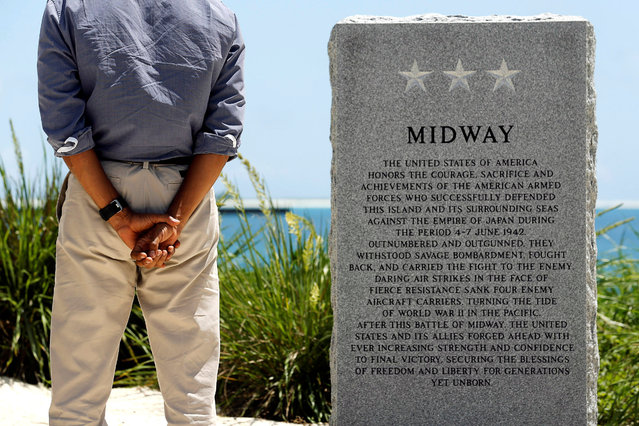 U.S. President Barack Obama pays his respects at a memorial to the Battle of Midway monument during a visit to the Papahanaumokuakea Marine National Monument, Midway Atoll, U.S. September 1, 2016. (Photo by Jonathan Ernst/Reuters)