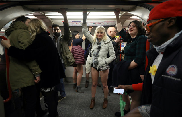 """Passengers without trousers travel on a London Underground train as part of the """"No Trousers on the Tube Day"""" event, in London, Britain January 7, 2018. (Photo by Simon Dawson/Reuters)"""