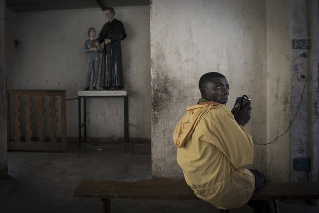 """""""Kamara Serbungo, 17, fled Rubabe (Rutshuru territory, North Kivu province of the Democratic Republic of the Congo) when rebel M23 soldiers entered the house of his family to forcibly enlist him. As a refugee in the Kanyaruchinya camp, he fled a second time when the M23 took over Goma. With other displaced persons he's now taking shelter at the Don Bosco parish"""". (Photo and comment by Colin Delfosse, Belgium/2013 Sony World Photography Awards"""