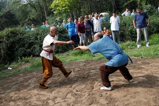 Kung Fu master Li Liangui (L) practices Shuaijiao (wrestling-styled Kung Fu) at a park in Beijing, China, June 30, 2016. (Photo by Kim Kyung-Hoon/Reuters)