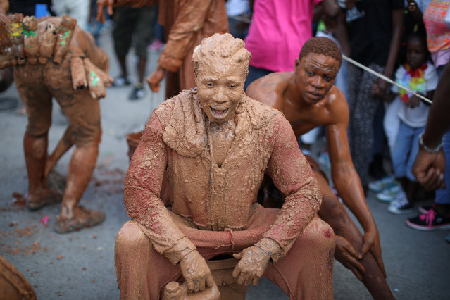 Revellers covered in mud parade along a street at the Carnival of Jacmel, Haiti, February 4, 2018. (Photo by Andres Martinez Casares/Reuters)