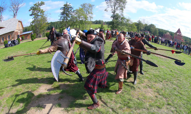 Actors stage a cold weapon fighting during a festival at a park in Minsk, Belarus, Sept. 19, 2020. The festival introducing Scottish history and culture in the Middle Ages was held on Saturday in Minsk. (Photo by Xinhua News Agency/Rex Features/Shutterstock)
