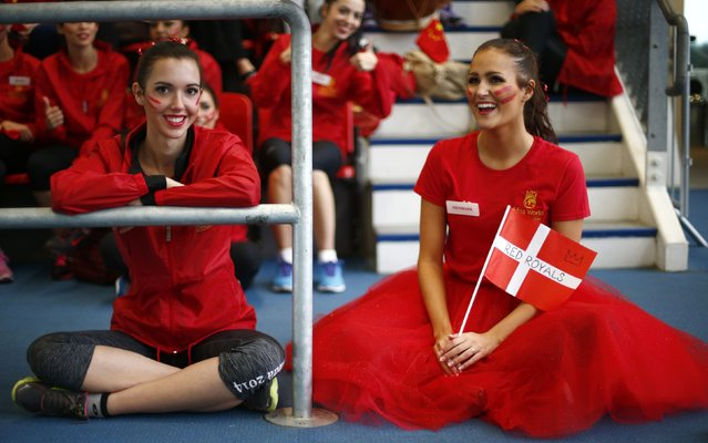 Miss Denmark (R) Pernille Sorensen and Miss Canada Annora Bourgeault watch an event during the Miss World sports competition at the Lee Valley sports complex in north London, November 26, 2014. (Photo by Andrew Winning/Reuters)