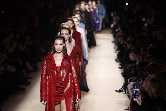 Model Bella Hadid, front, leads other models as they wear creations as part of the Roberto Cavalli women's Fall/Winter 2018-2019 collection, presented during the Milan Fashion Week, in Milan, Italy, Friday, February 23, 2018. (Photo by Antonio Calanni/AP Photo)
