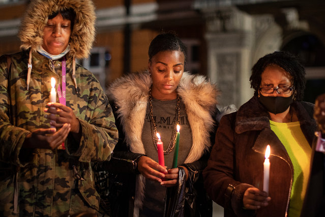 A small group hold a candlelit vigil to mark what would have been the birthday of George Floyd, in Windrush Square in Brixton on October 14, 2020 in the Brixton neighborhood of London, England. Today would have been the 47th birthday of George Floyd, an American man who was killed in police custody on May 25th in the U.S. city of Minneapolis. His death sparked a wave of anti-racism and anti-police brutality protests around the world. (Photo by Dan Kitwood/Getty Images)