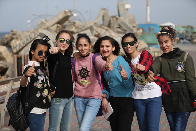 Palestinian school girls pose for a group picture during a school trip in Gaza City on March 8, 2018 to mark Women's Day. (Photo by Mohammed Abed/AFP Photo)