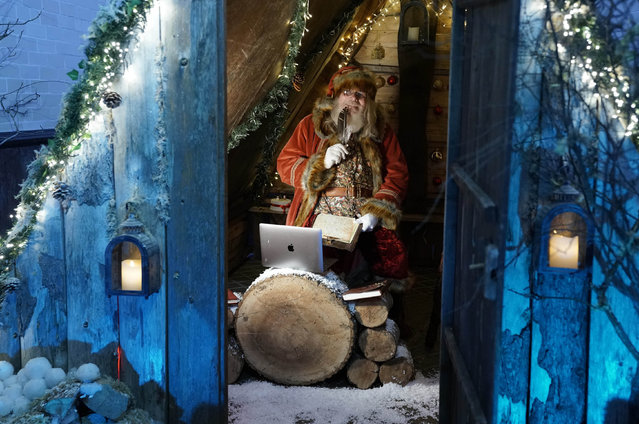 A man dressed as Father Christmas learns how to use Zoom on a laptop in the grotto at Bamburgh castle in Northumberland, UK on November 3, 2020, it was due to open on November the 21st but due to the new national lockdown he will now be speaking to the children via Zoom on a computer. (Photo by Owen Humphreys/PA Images via Getty Images)