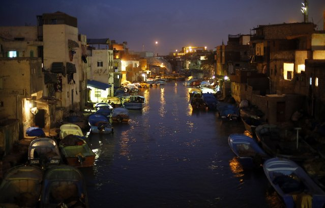 Boats are moored in front of houses in the fishermen's village in El Max in the Mediterranean city of Alexandria October 18, 2014. (Photo by Amr Abdallah Dalsh/Reuters)