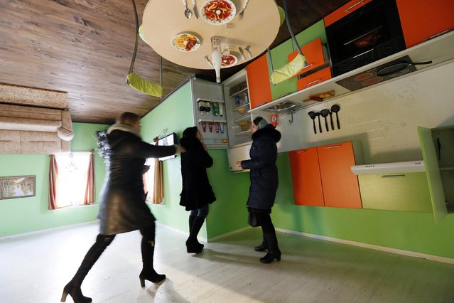 People visit a house built upside-down in Russia's Siberian city of Krasnoyarsk, December 14, 2014. (Photo by Ilya Naymushin/Reuters)