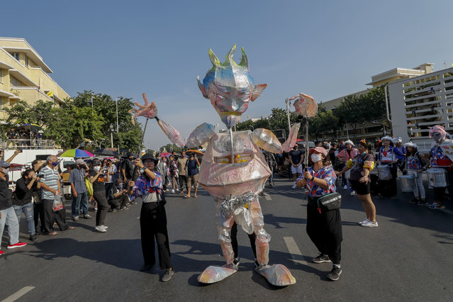 A puppet features during a protest march led by pro-democracy protesters close to Democracy Monument in Bangkok, Thailand, Saturday, November 14, 2020. (Photo by Sakchai Lalit/AP Photo)