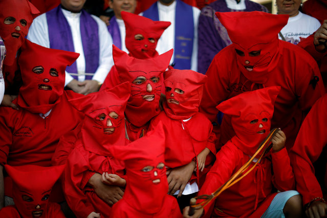 Men and children dressed as demons pose for pictures prior to the ceremony known as Los Talciguines, as part of religious activities to mark the start of the Holy Week in Texistepeque, El Salvador, March 26, 2018. (Photo by Jose Cabezas/Reuters)