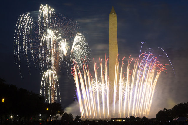 Fireworks burst over Washington Monument at the National Mall during Independence Day celebrations in Washington, DC on July 4, 2020. (Photo by Jose Luis Magana/AFP Photo)