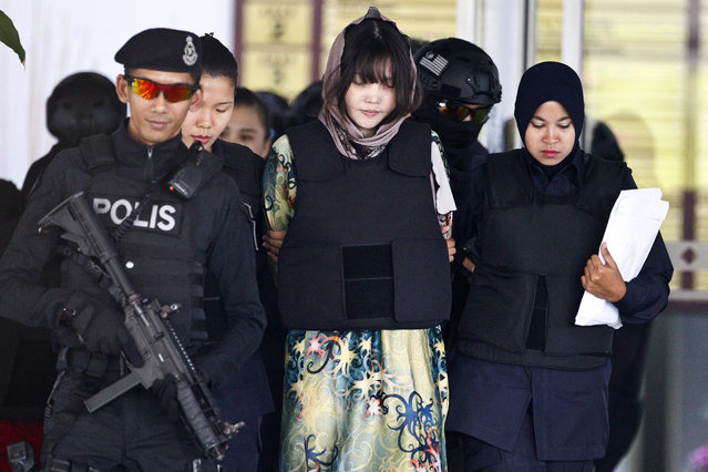Vietnamese Doan Thi Huong, center, is escorted by police as she leaves after a court hearing at the Shah Alam High Court in Shah Alam, Malaysia, Thursday, April 5, 2018. Doan and Siti Aisyah of Indonesia have pleaded not guilty of killing Kim Jong Nam, the estranged brother of North Korean leader Kim Jong Un, on Feb. 13, 2017, at a crowded Kuala Lumpur airport terminal. (Photo by Sadiq Asyraf/AP Photo)