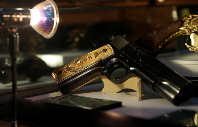 A gun decorated with gold and jewellery belonging to Mexican drug lord Amado Carrillo Fuentes is displayed in the Drugs Museum, used by the military to showcase to soldiers the lifestyles of Mexican drug lords, at the headquarters of the Ministry of Defense in Mexico City, October 14, 2016. (Photo by Henry Romero/Reuters)