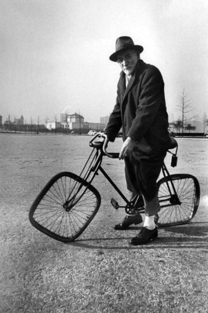 Square-wheeled bike held by Bernard Steinlauf was built by son Dave after seeing a bicycle wreck, 1948. (Photo by Wallace Kirkland/Time & Life Pictures)